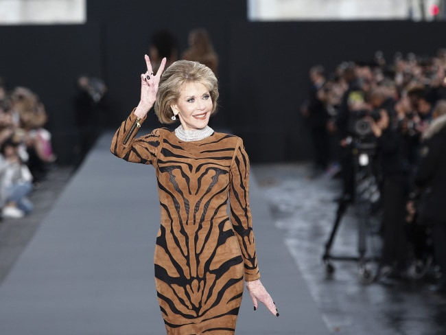 Jane Fonda flashes a peace sign at the L'Oreal Spring/Summer 2018 ready-to-wear fashion collection. Photo: AP/Kamil Zihnioglu