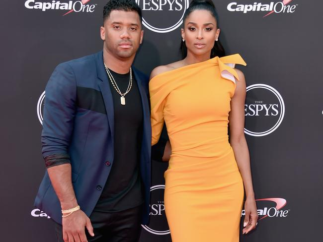NFL player Russell Wilson (L) and singer Ciara are adorable together.