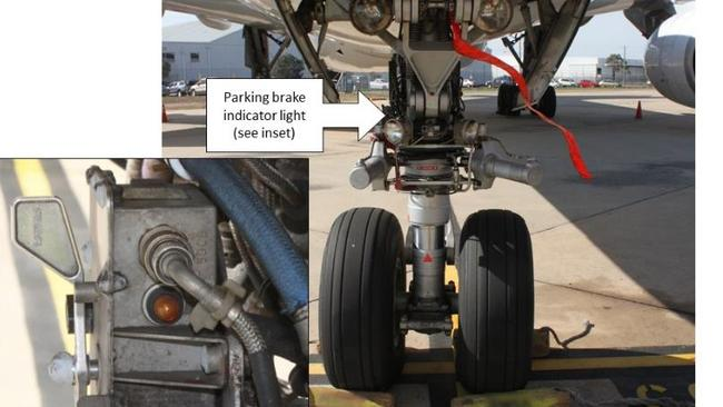 Safety first. ATSB photo showing the parking brake indicator light which made maintenance engineers think it was safe to remove wheel chocks at Melbourne Airport. Picture: ATSB