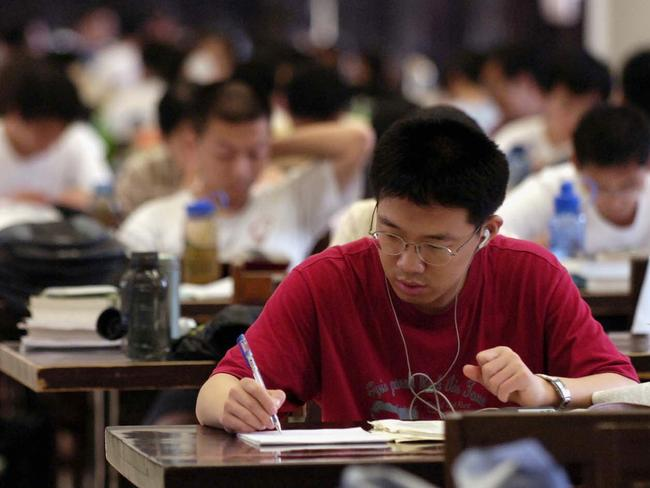 A student studies at a Tsinghua University library in Beijing, China. The Chinese government is pouring resources into universities, but now it is worried students aren't Communist enough. Picture: Getty
