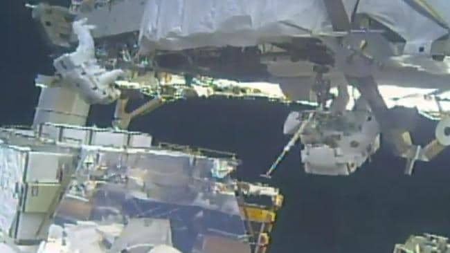 In this image take from NASA video, Koch (left) and Meir (right) install batteries for the International Space Station's solar power grid during a space walk. Picture: NASA via AP