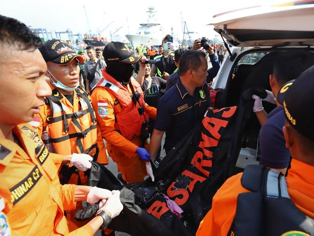 Members of a rescue team transfer body bags into a vehicle at the port in Tanjung Priok, North Jakarta. Picture: AP