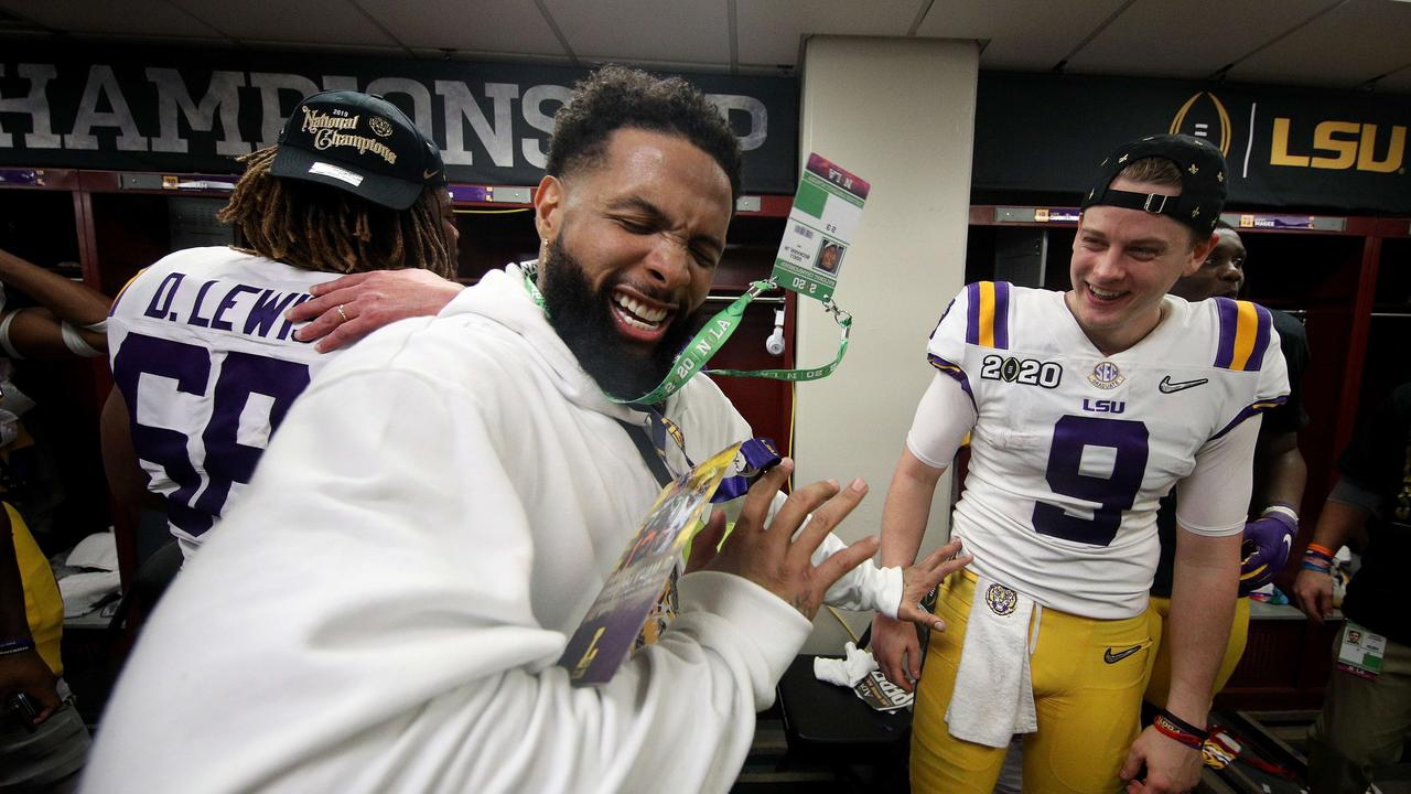 Odell Beckham Jr. celebrates in the locker room with Joe Burrow after LSU won the national championships.