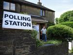 A voter leaves afer casting his ballot paper at a polling station set up inisde a residential house in Rochdale, northern England, on June 23, 2016, as Britain holds a referendum to vote on whether to remain in, or to leave the European Union (EU). Millions of Britons began voting Thursday in a bitterly-fought, knife-edge referendum that could tear up the island nation's EU membership and spark the greatest emergency of the bloc's 60-year history. / AFP PHOTO / OLI SCARFF
