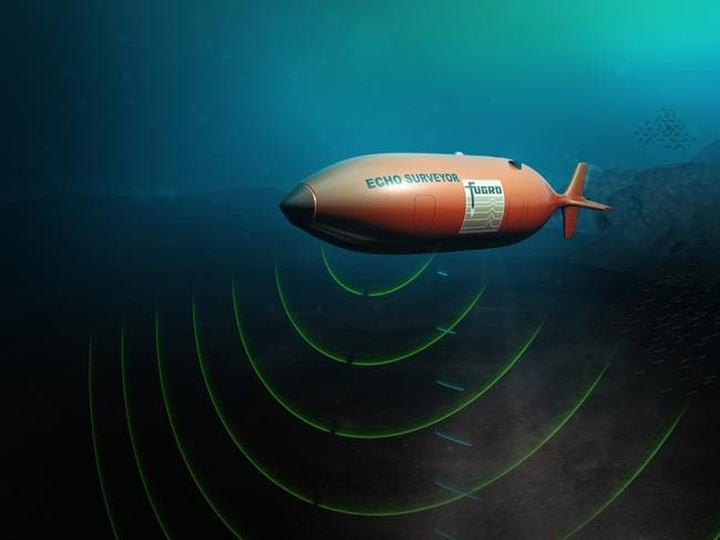Looking for clues ... a Fugro autonomous underwater vehicle (AUV) launched from the Australian-contracted survey ship Fugro Discovery to help find MH370. Picture: AFP