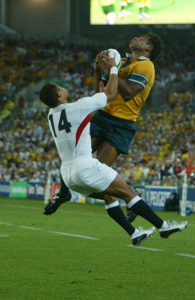 Lote Tuqiri climbs over Jason Robinson to score the first try against England in the 2003 World Cup Final in Sydney.