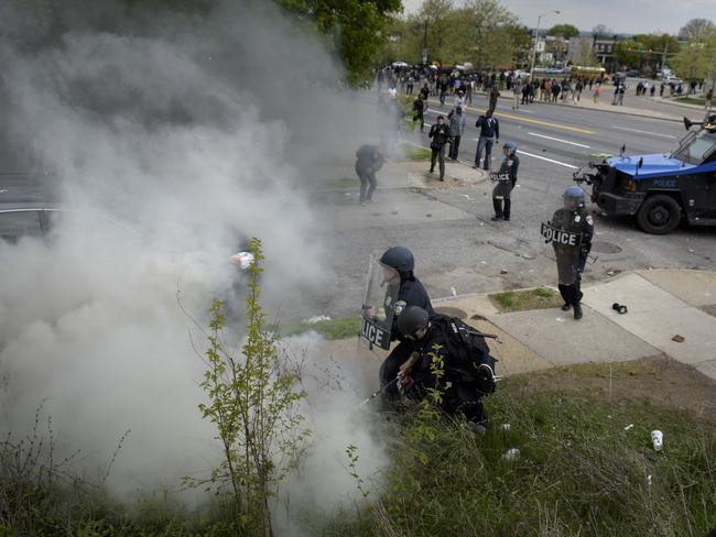 Out of control ... Police try to put out a fire lit by protesters. Picture:AFP/BRENDAN SMIALOWSKI