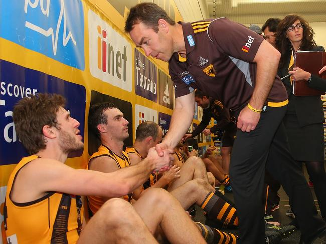 Hawthorn coach Alastair Clarkson shakes hands with Grant Birchall after the win.