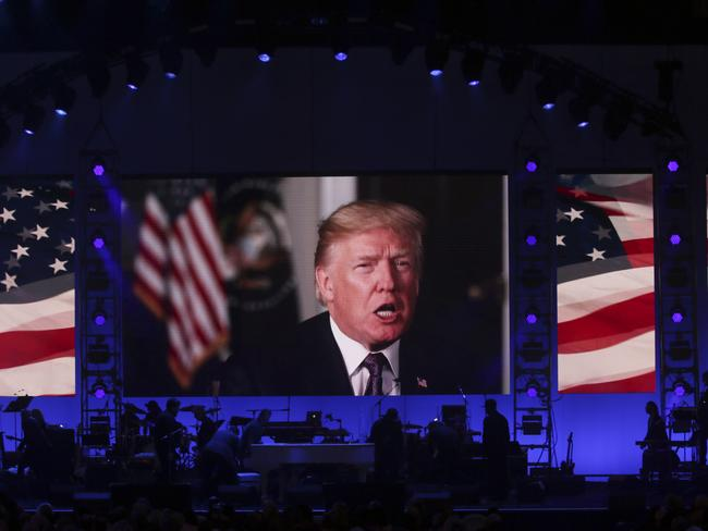 Donald Trump appeared via video message at a hurricane relief benefit attended by four former US presidents over the weekend. Picture: AP/LM Otero