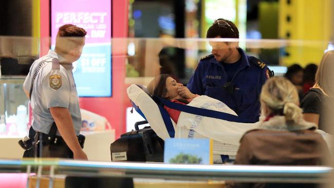 Horrified ... A shopper is cared for by paramedics. Picture Craig Greenhill