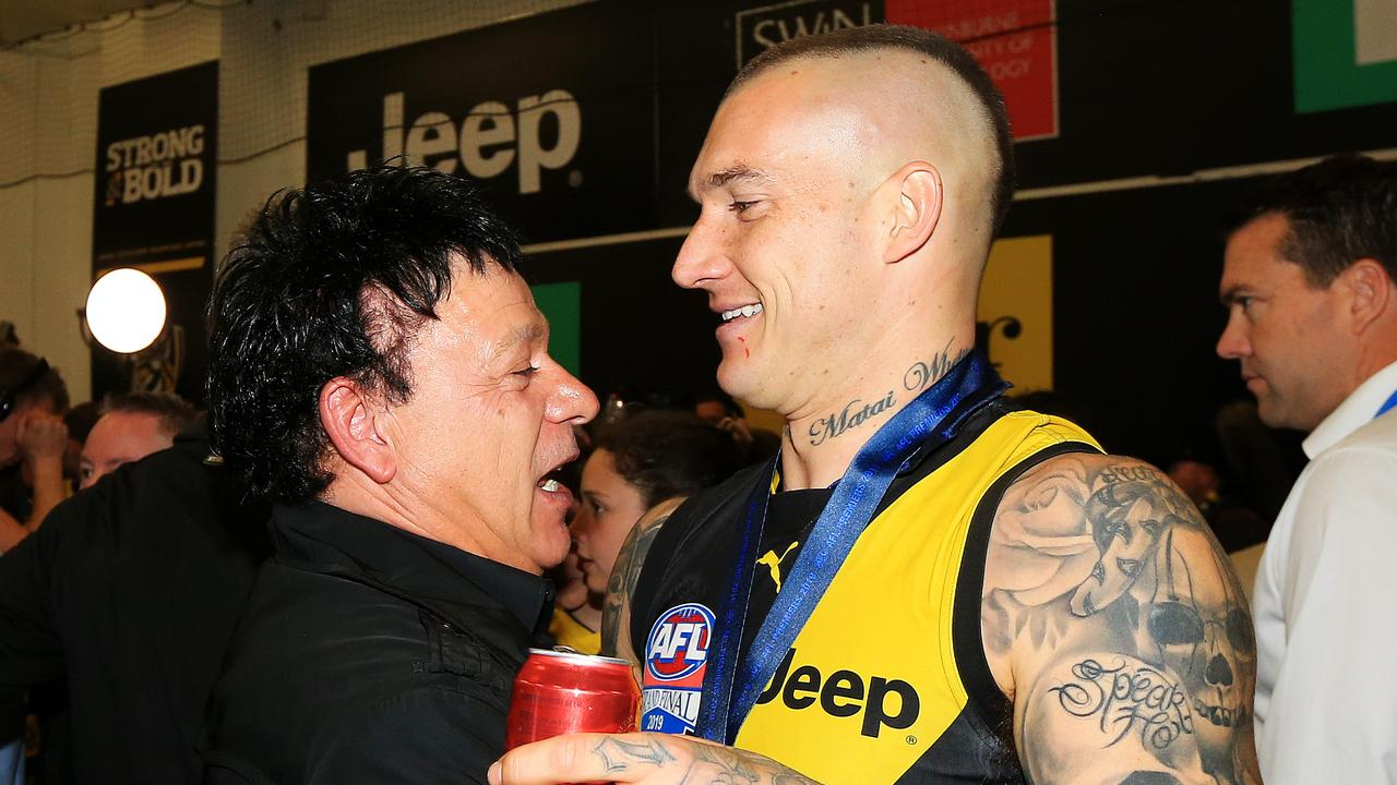Dustin Martin with his manager Ralph Carr following Richmond's 2019 AFL grand final victory. Picture: Mark Stewart