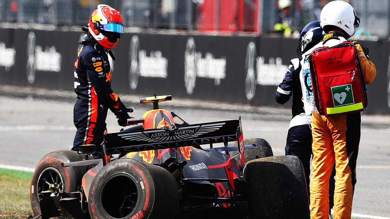 Gasly climbs from his car after crashing during Friday practice at the Hockenheimring.