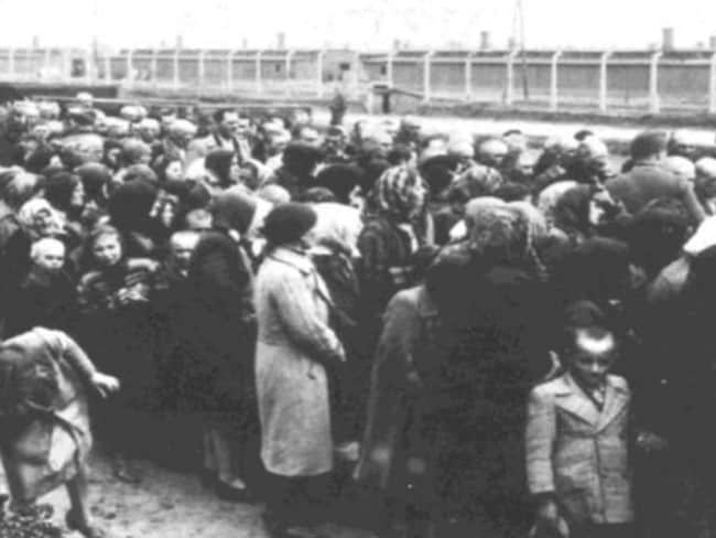 Jewish women and children waiting for a selection at the ramp in Birkenau. This is where the Nazis decided if prisoners lived or died.