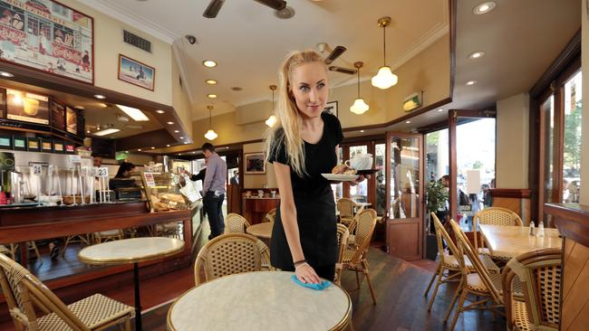 Waitress Laura Gadliauskaite at work at Cafe de la France on George St, Sydney, which has become a ghost town thanks to the Light Rail project. Picture: John Fotiadis