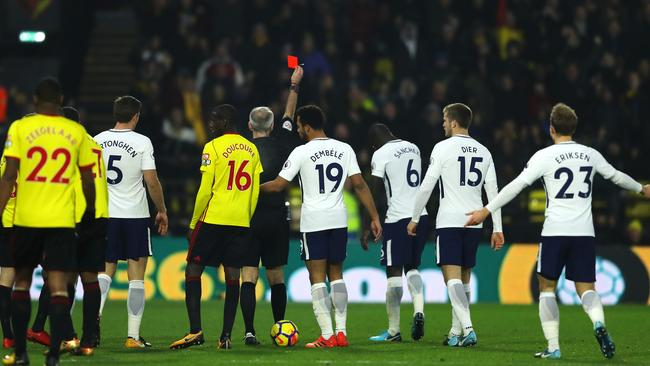 Davinson Sanchez of Tottenham Hotspur is shown a red card by referee Martin Atkinson.