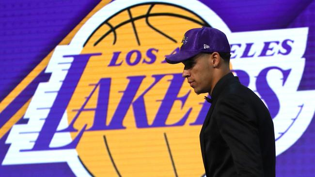 Lonzo Ball walks on stage after being drafted second overall by the Lakers.