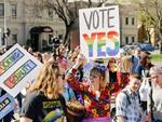 "A supporter is seen with a 'Vote Yes' sign on King William St during the march at the ""Yes"" To Marriage Equality Rally at Parliament House, Adelaide. Picture: AAP"