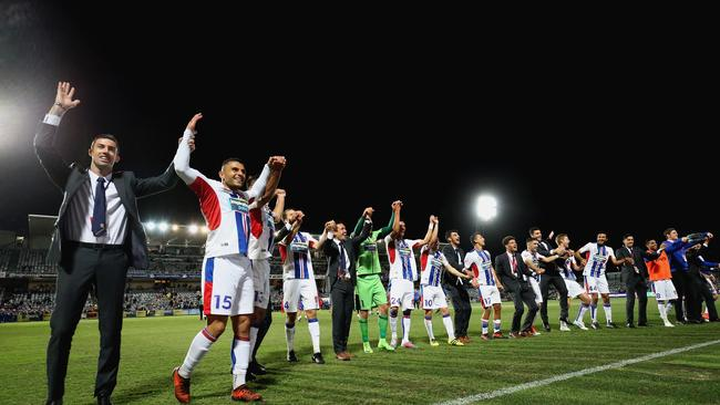 Newcastle Jets team celebrates the win during the round one A-League match