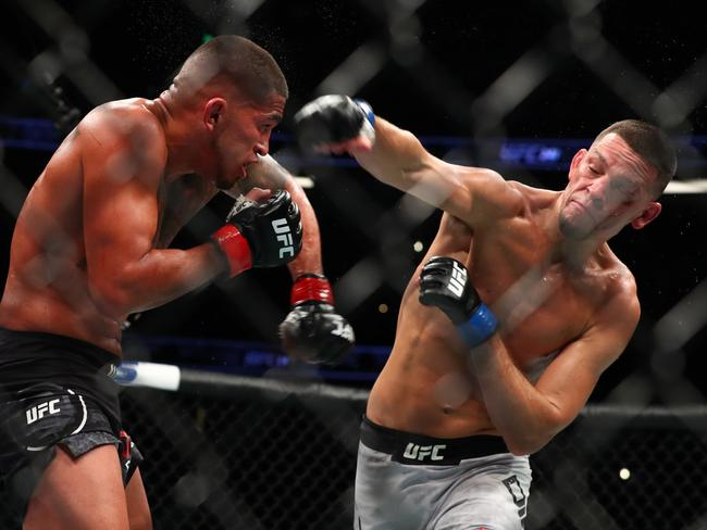 Nate Diaz throws a punch at Anthony Pettis. Picture: Joe Scarnici/Getty Images