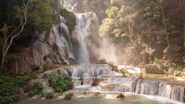 The magical Kuang Si Falls in Laos.