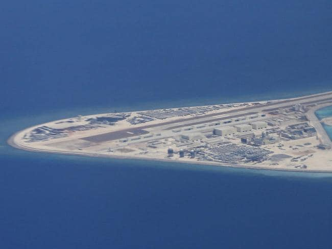 An airstrip, structures and buildings on China's manmade Subi Reef in the Spratly chain of islands in the South China Sea. Picture: AP Photo/Bullit Marquez