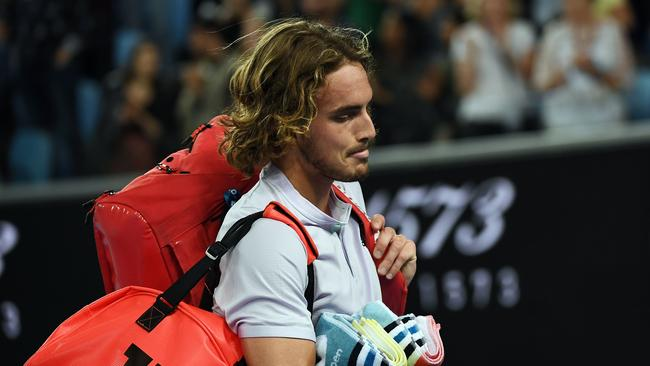 A dejected Stefanos Tsitsipas leaves the court. Picture: Manan Vatsyayana/AFP