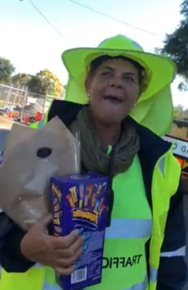 Brisbane traffic controller spreads happiness on Warrigal Road
