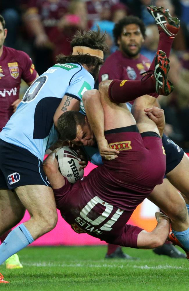 NSW's Greg Bird tackles QLD's Nate Myles.