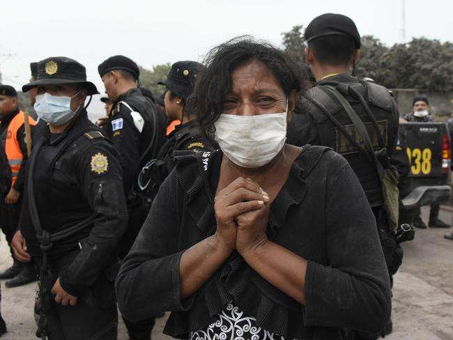 A woman cries for her missing relatives during the search for victims in San Miguel Los Lotes. Picture: AFP/Johan Ordonez