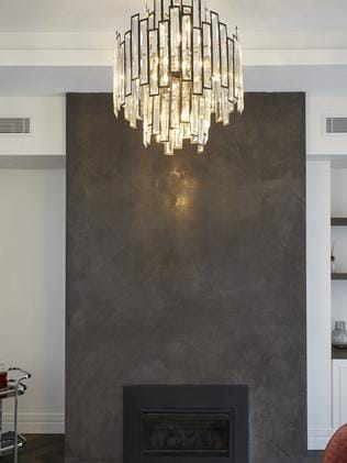 They loved this chandelier but said it could have been bigger to reflect off the fireplace wall. Picture: The Block