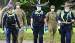 Victoria Police and members of the ADF patrol the popular running track around Melbourne's Botanical Gardens on the first day masks are compulsory during a Covid-19 Stage Three lockdown. Picture: Mark Stewart