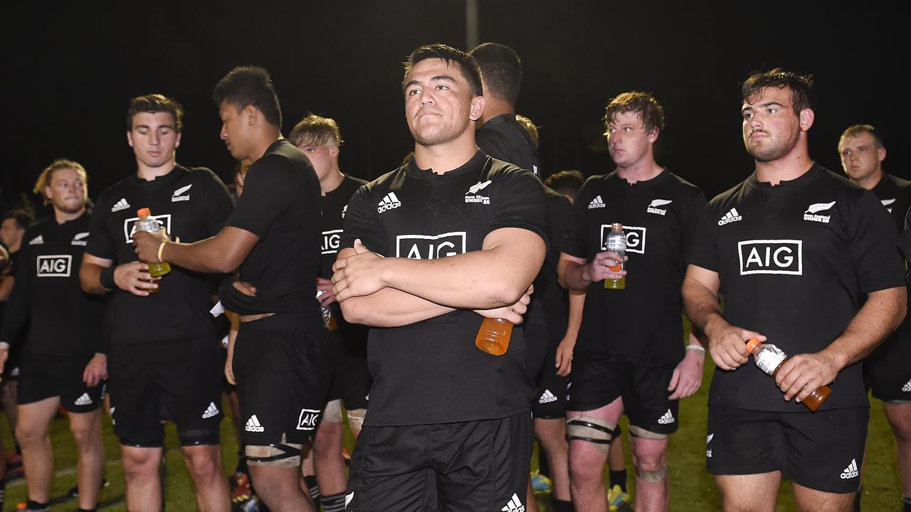 New Zealand players look dejected after their defeat at Bond University.