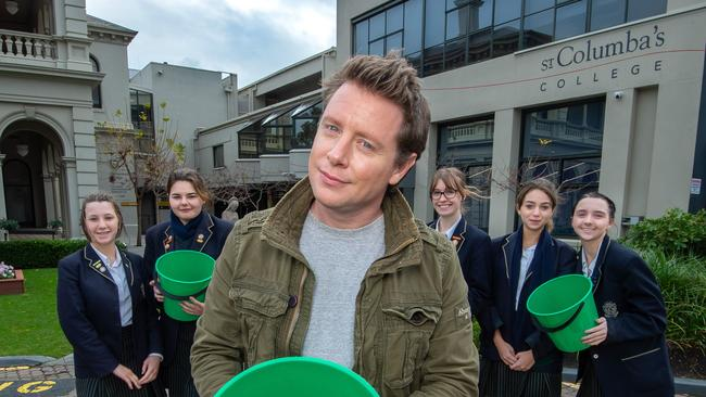 Scott Pape at St.Columba's College in Melbourne with Year 11 and 12 students from the VCAL class, working on his money program in schools, called Money Movement which is helping teach kids about financial literacy. Picture Jay Town