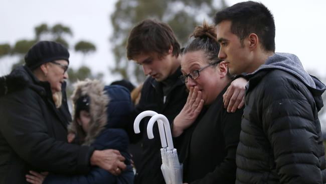 Family members gather in Royal Park. Picture: Getty Images
