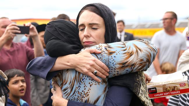 New Zealand Prime Minister Jacinda Ardern comforts a mosque-goer two days after the Christchurch massacre.
