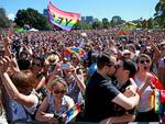 Marriage Equality supporters, who gathered at Prince Alfred Park in Surry Hills ahead of the plebiscite announcement, react to the Yes announcement. Picture: Toby Zerna