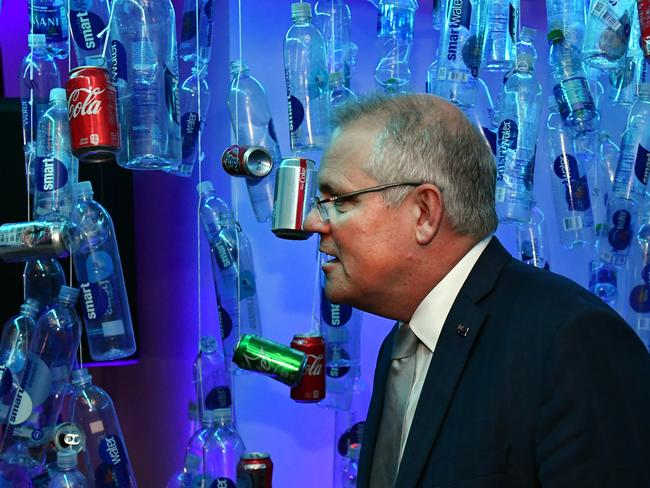 Prime Minister Scott Morrison walks past a plastic bottle installation at a clean oceans event at the United Nations in New York. Picture: Mick Tsikas/AAP