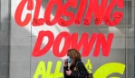 A woman walks past an empty shop in Melbourneâs central business district on August 3, 2020 after the state announced new restrictions as the city battles fresh outbreaks of the COVID-19 coronavirus. - lia's Victoria state imposed fresh, sweeping restrictions on August 2, 2020, including a curfew in Melbourne for the next six weeks, a ban on weddings, and schools and universities going back online in the coming days. (Photo by William WEST / AFP)