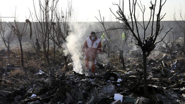 Rescue workers search the scene where an Ukrainian plane crashed in Shahedshahr, southwest of the capital Tehran, Iran, on January 8, 2020. Picture: AP /Ebrahim Noroozi.
