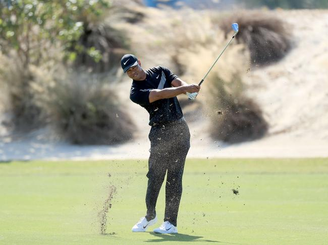 Tiger Woods plays his third shot on the third hole during the opening round of the 2019 Hero World Challenge at Albany in the Bahamas. Picture: David Cannon/Getty Images/AFP