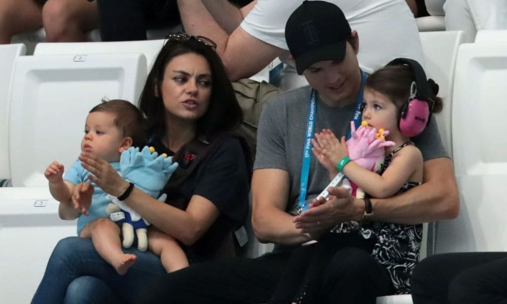 US actors Ashton Kutcher and his wife Mila Kunis attend the diving competition at the 2017 FINA World Championships in Budapest, on July 17, 2017. / AFP PHOTO / STRINGER (Photo credit should read STRINGER/AFP/Getty Images)