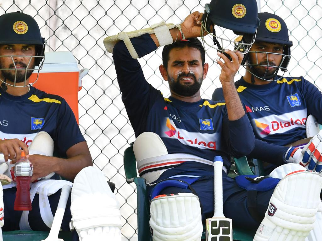 Dinesh Chandimal (left), Lahiru Thirimanne (centre) and Roshen Silva (right) of Sri Lanka are seen during a training session at the Gabba in Brisbane, Tuesday, January 22, 2019. Sri Lanka are preparing to play Australia in the First Test starting on Thursday in Brisbane. (AAP Image/Darren England) NO ARCHIVING