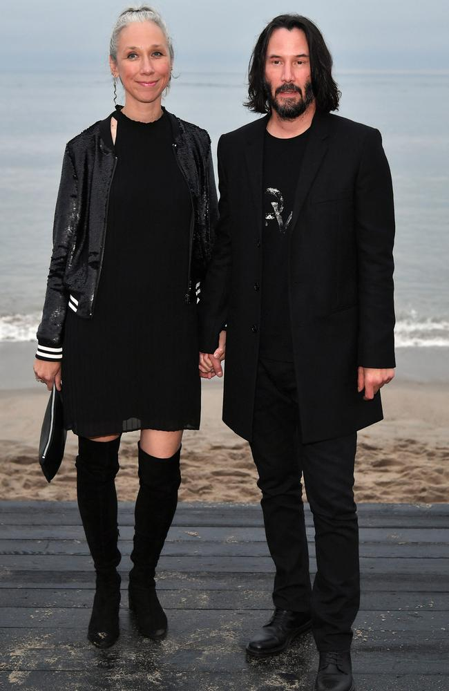 The fashionable pair looked loved-up at a Saint Laurent runway show this year. Picture: Neilson Barnard/Getty Images