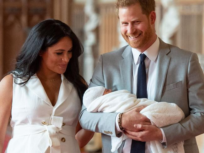 Bearded Harry joked that the baby already had facial hair, as they showed off their two-day-old son before introducing him to the Queen. Picture: Dominic Lipinski / POOL / AFP