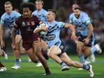 Damien Cook of the Blues breaks through the Queensland defence during game three of the State of Origin series between the Queensland Maroons and the New South Wales Blues at Suncorp Stadium on July 11, 2018 in . (Photo by Mark Kolbe/Getty Images)