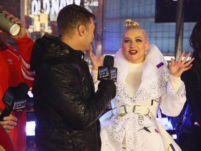 Ryan Seacrest and Christina Aguilera speak on stage during Dick Clark's New Year's Rockin' Eve With Ryan Seacrest. Picture: AP