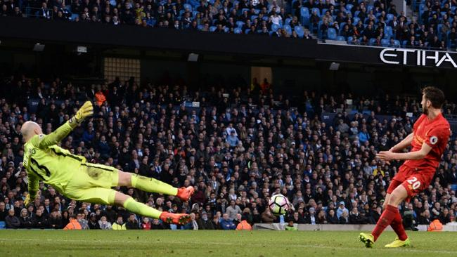 Liverpool's English midfielder Adam Lallana manages to miss his shot on goal.
