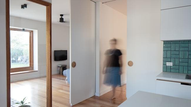 A large sliding door creates zoned living.
