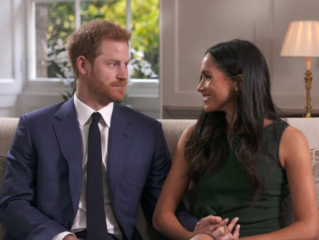 Prince Harry and Meghan Markle chat about their engagement during an interview in London. Photo: Pool via AP