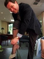 Does he regret this photo? Then-Foreign Minister Alexander Downer wears a fishnet stocking and a high-heeled shoe to promote The Rocky Horror Picture Show - and to raise money for charities through Variety.